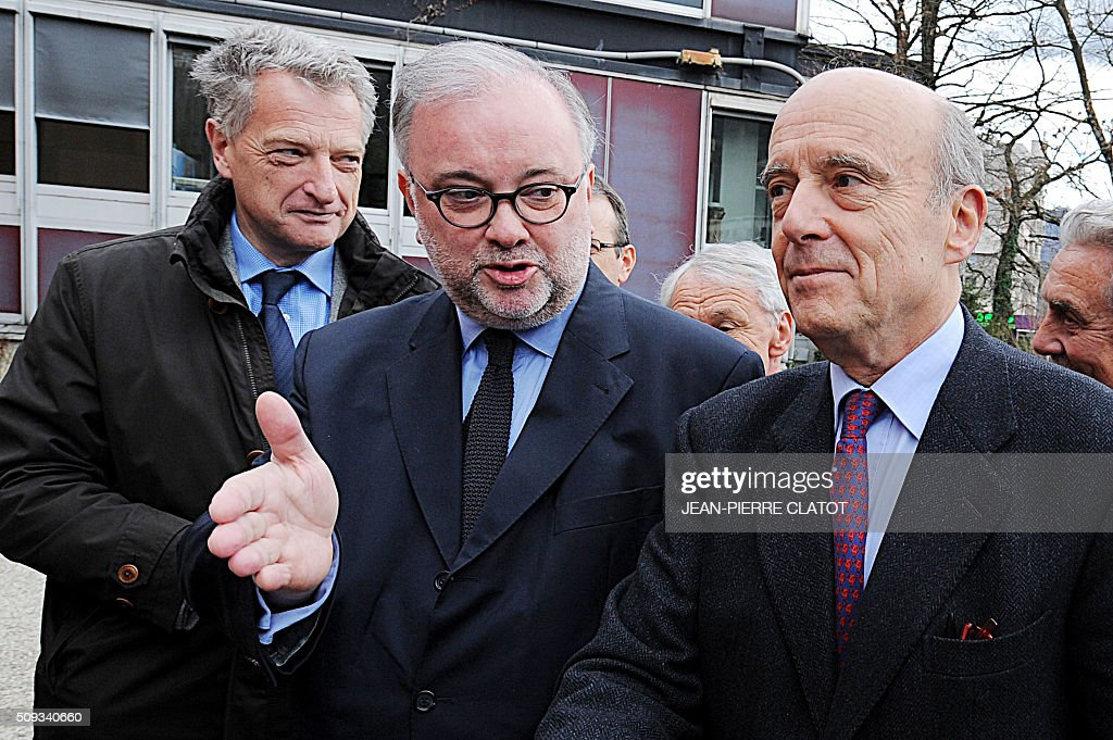 Mayor of Bordeaux and candidate for Les Republicains right-wing party primary Alain Juppe arrives in Meylan, eastern france, for a meeting about security, video-surveillance and police equipment with Mayor of Meylan Damien Guiguet as part of a trip in Grenoble on February 10, 2016. / AFP / JEAN-PIERRE CLATOT