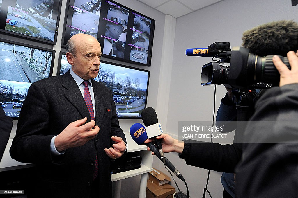 Mayor of Bordeaux and candidate for Les Republicains right-wing party primary Alain Juppe answers questions to journalists as part of a presentation of police video-surveillance system in Meylan, eastern france on February 10, 2016. / AFP / JEAN-PIERRE CLATOT