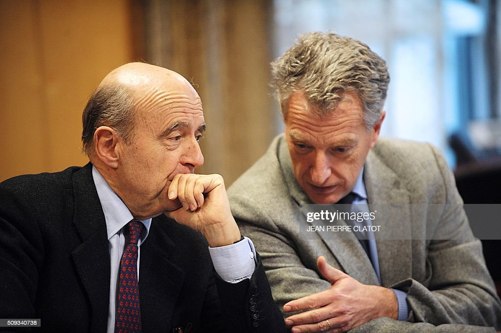 Mayor of Bordeaux and candidate for Les Republicains right-wing party primary Alain Juppe (L) discusses with French MP Herve Gaymard as part of a meeting with stakeholders about security in Meylan, eastern france on February 10, 2016. / AFP / JEAN PIERRE CLATOT