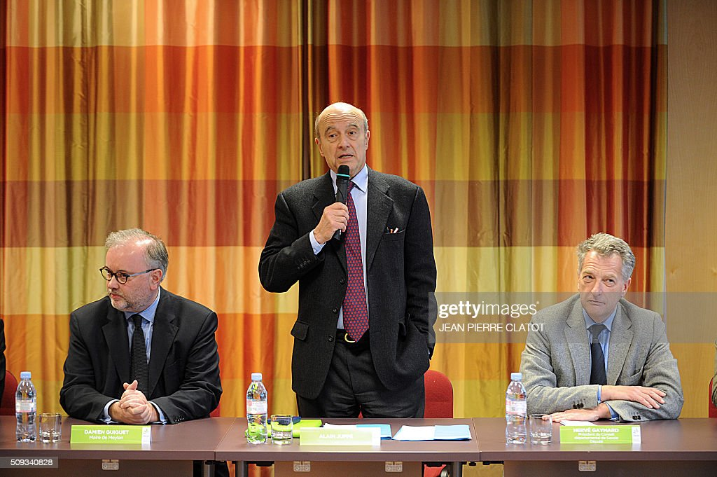 Mayor of Bordeaux and candidate for Les Republicains right-wing party primary Alain Juppe (C) speaks during a meeting with stakeholders about security in Meylan, eastern france, flanked by Mayor of Meylan Damien Guiguet (L) and French MP Herve Gaymard on February 10, 2016. / AFP / JEAN PIERRE CLATOT