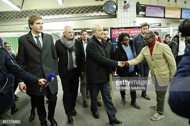 Mayor of Bordeaux and candidate for the rightwing Les Republicains party primaries ahead of the 2017 presidential election Alain Juppe flanked by...