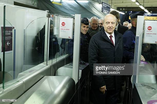 Mayor of Bordeaux and candidate for the rightwing Les Republicains party primaries ahead of the 2017 presidential election Alain Juppe passes through...