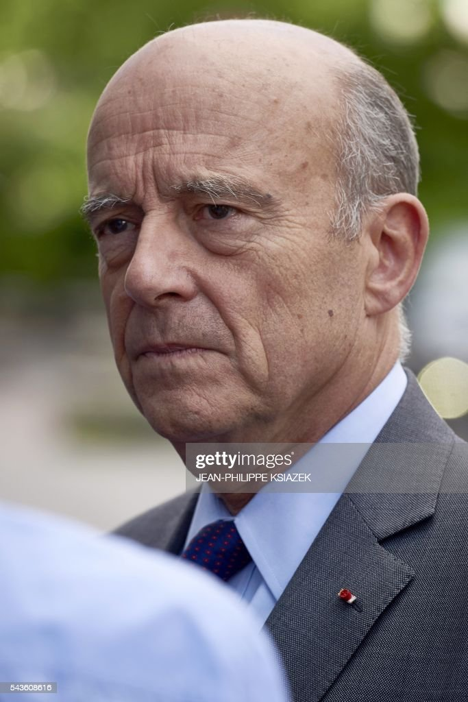 Mayor of Bordeaux and presidential candidate of the opposition Les Republicains (LR) party for the French presidential elections in 2017 Alain Juppe, looks on as he visits the Halles de Lyon Paul Bocuse, on June 29, 2016. / AFP / JEAN