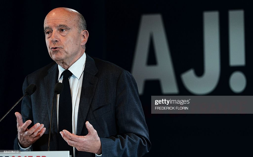 Mayor of Bordeaux, France's former Prime minister and candidate for 'Les Republicains' party's primary for the 2017 presidential elections, Alain Juppe, delivers a speech during a campaign rally in Mulhouse , eastern France on May 25, 2016. / AFP / FREDERICK
