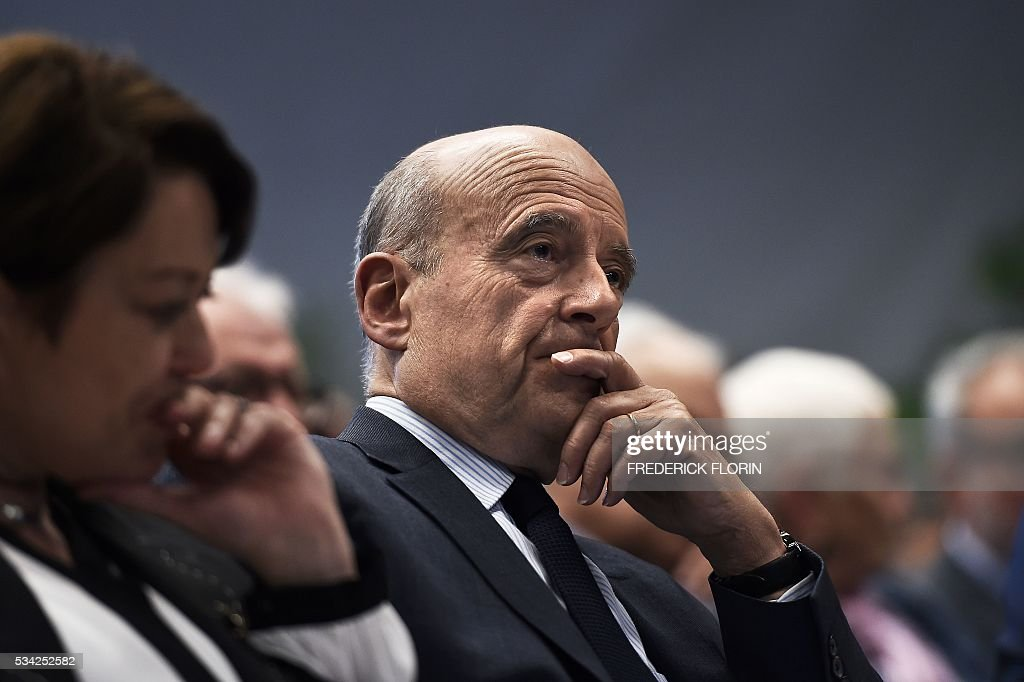 Mayor of Bordeaux, France's former Prime minister and candidate for 'Les Republicains' party's primary for the 2017 presidential elections, Alain Juppe, attends a campaign rally in Mulhouse , eastern France on May 25, 2016. / AFP / FREDERICK