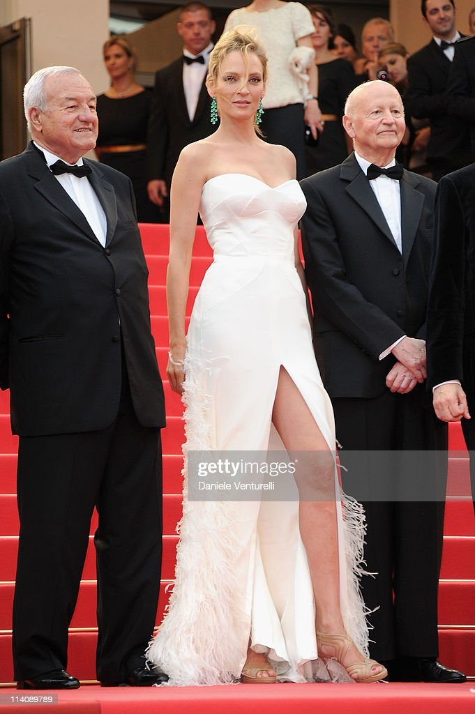 Mayor of Cannes, Bernard Brochand, Jury member Uma Thurman and Cannes Film Festival President Gilles Jacob attend the Opening Ceremony and 'Midnight In Paris' Premiere at the Palais des Festivals during the 64th Cannes Film Festival on May 11, 2011 in Cannes, France.