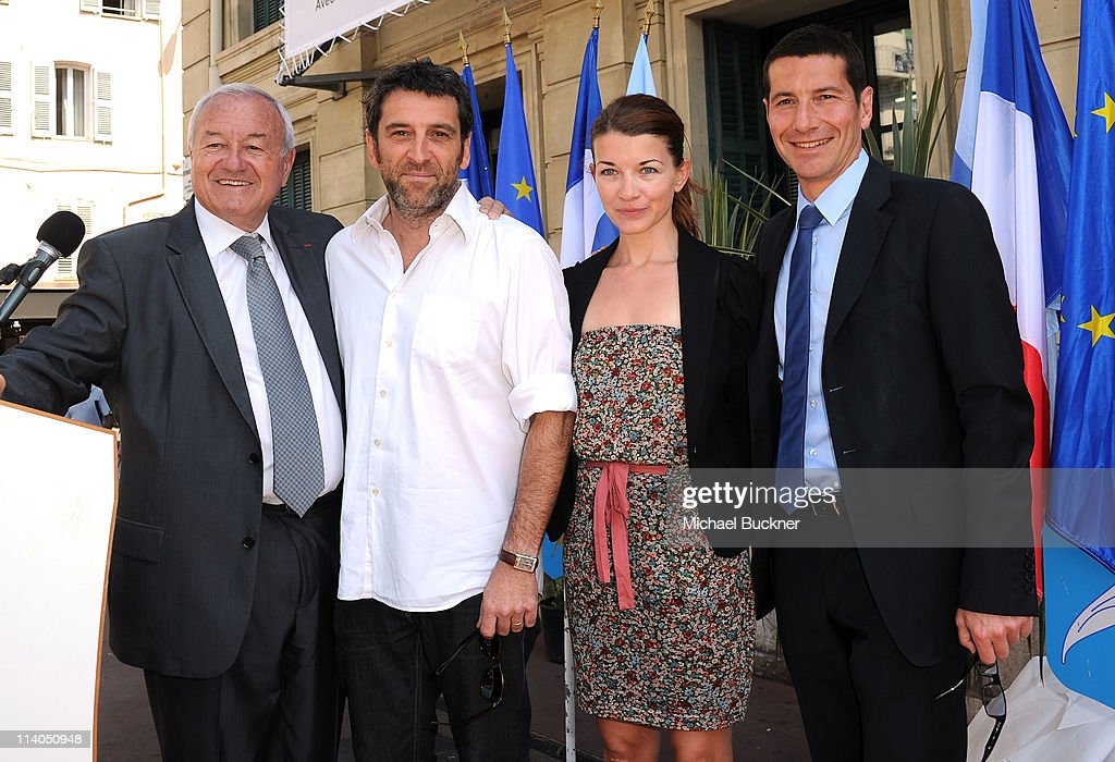 Mayor of Cannes <a gi-track='captionPersonalityLinkClicked' href=/galleries/search?phrase=Bernard+Brochand&family=editorial&specificpeople=2394506 ng-click='$event.stopPropagation()'>Bernard Brochand</a>, photographer Marcel Hartmann, Contour by Getty Images' Clotilde Lecuillier and David Lisnard attends the 'Cannes Fait Le Mur' exhibition opening during the 64th Cannes Film Festival on May 11, 2011 in Cannes, France.
