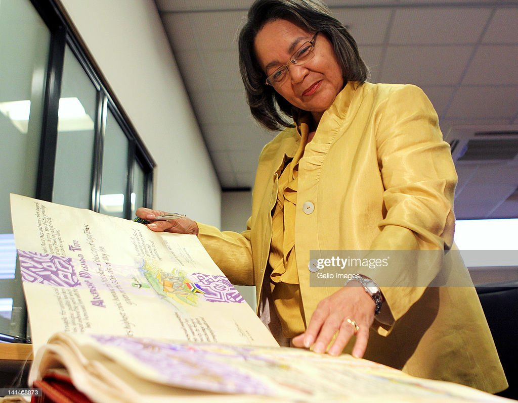 Mayor of Cape Town, Patricia de Lille looks through a book detailing past recipients of the Freedom of the City on May 14, 2012 in Cape Town, South Africa. De Lille announced that American president Barack Obama and first lady Michelle Obama will be awarded the Freedom of the City of Cape Town.