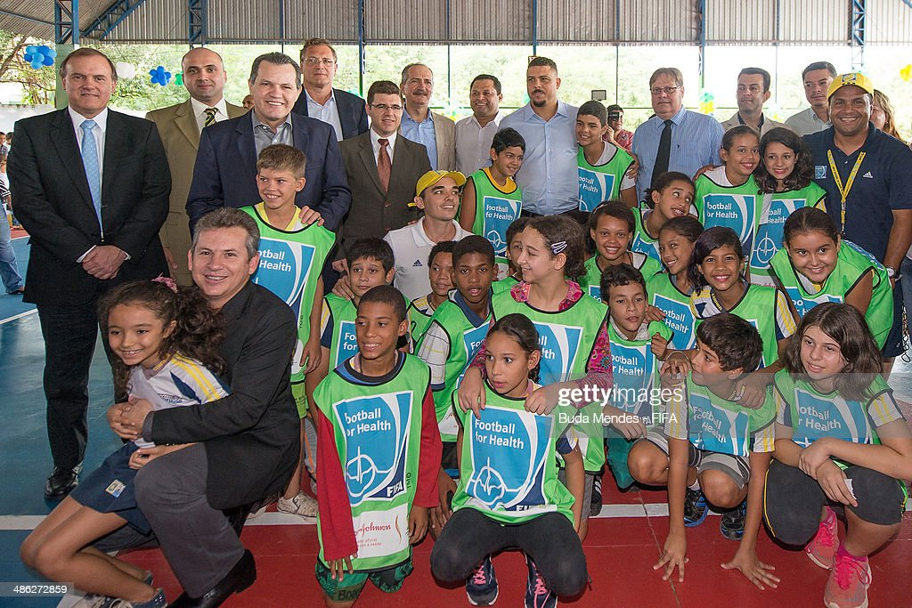 Mayor of Cuiaba Mauro Mendes (2L) Governor of Mato Grosso Silval Barbosa (4L), FIFA Secretary General <a gi-track='captionPersonalityLinkClicked' href=/galleries/search?phrase=Jerome+Valcke&family=editorial&specificpeople=4375385 ng-click='$event.stopPropagation()'>Jerome Valcke</a> (5L), Brazil Sports Minister <a gi-track='captionPersonalityLinkClicked' href=/galleries/search?phrase=Aldo+Rebelo&family=editorial&specificpeople=772117 ng-click='$event.stopPropagation()'>Aldo Rebelo</a> (7L) and LOC Member Ronaldo Luis Nazario (C) pose for photo with kids during visit the FIFA 11 for Health Program as part of the 2014 FIFA World Cup Host City Tour on April 23, 2014 in Cuiaba, Brazil