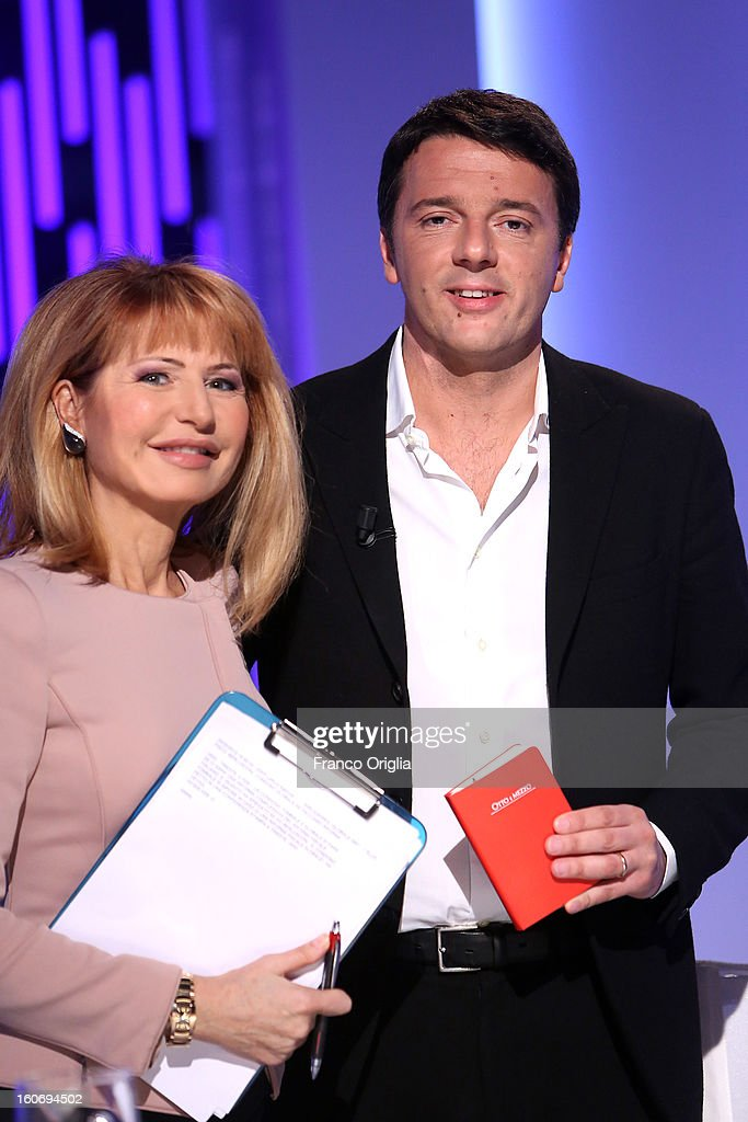 Mayor of Florence and Democratic Party (PD) member <a gi-track='captionPersonalityLinkClicked' href=/galleries/search?phrase=Matteo+Renzi&family=editorial&specificpeople=6689301 ng-click='$event.stopPropagation()'>Matteo Renzi</a> (R) and tv conductor Lilli Gruber (L) attend 'Otto e Mezzo' Italian TV Show at La7 studios on February 4, 2013 in Rome, Italy. The 2012 Italian centre-left primary election determined the leader of the coalition. Common Good, who will stand as common candidate for the office of Prime Minister in the subsequent general election, which will be held on February 24, 2013. It was won with 61% of the votes by Pier Luigi Bersani, who defeated the 37-years old mayor of Florence <a gi-track='captionPersonalityLinkClicked' href=/galleries/search?phrase=Matteo+Renzi&family=editorial&specificpeople=6689301 ng-click='$event.stopPropagation()'>Matteo Renzi</a> in the run-off.