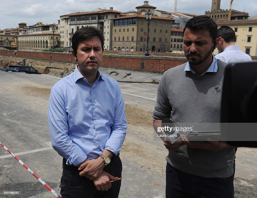 Mayor of Florence Dario Nardella (L) speaks to the media after a road collapses along Arno river on May 25, 2016 in Florence, Italy. The deterioration of one or more water pipes opened a 200 m wide and 7m deep hole on Wednesday morning along the bank of the river Arno close to the famous Ponte Vecchio bridge. Many cars that were parked sunk and damages are thought to be around 5 millions euros.
