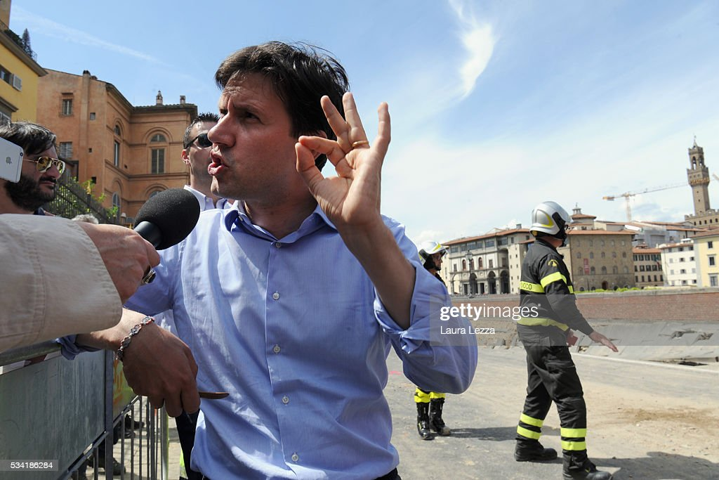 Mayor of Florence Dario Nardella speaks to the media after a road collapses along the Arno river on May 25, 2016 in Florence, Italy. The deterioration of one or more water pipes opened a 200 m wide and 7m deep hole on Wednesday morning along the bank of the river Arno close to the famous Ponte Vecchio bridge. Many cars that were parked sunk and damages are thought to be around 5 millions euros.