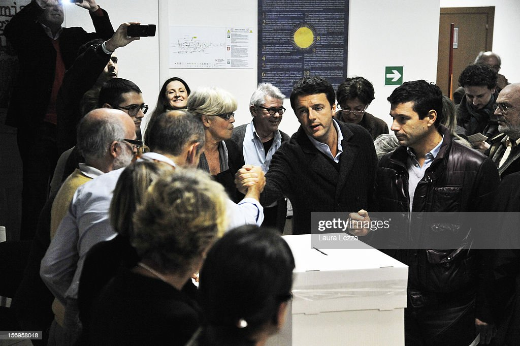 Mayor of Florence <a gi-track='captionPersonalityLinkClicked' href=/galleries/search?phrase=Matteo+Renzi&family=editorial&specificpeople=6689301 ng-click='$event.stopPropagation()'>Matteo Renzi</a> greets some people before voting in the PD Primary Elections on November 25, 2012 in Florence, Italy. None of the five candidates won a 50 percent majority vote today. <a gi-track='captionPersonalityLinkClicked' href=/galleries/search?phrase=Matteo+Renzi&family=editorial&specificpeople=6689301 ng-click='$event.stopPropagation()'>Matteo Renzi</a>, who received more than 36 percent of the vote, will face the head of Italy's Democratic Party Pier Luigi Bersani in a runoff next weekend to choose the center-left leader that will be the candidate for the next Italian election to succeed Mario Monti.