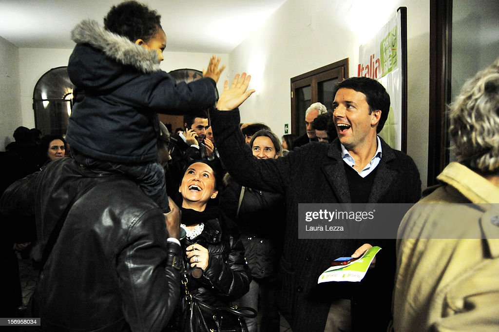 Mayor of Florence Matteo Renzi greets voters while lining up to vote in the 2012 PD Primary Elections on November 25, 2012 in Florence, Italy. None of the five candidates won a 50 percent majority vote today. Matteo Renzi, who received more than 36 percent of the vote, will face the head of Italy's Democratic Party Pier Luigi Bersani in a runoff next weekend to choose the center-left leader that will be the candidate for the next Italian election to succeed Mario Monti.