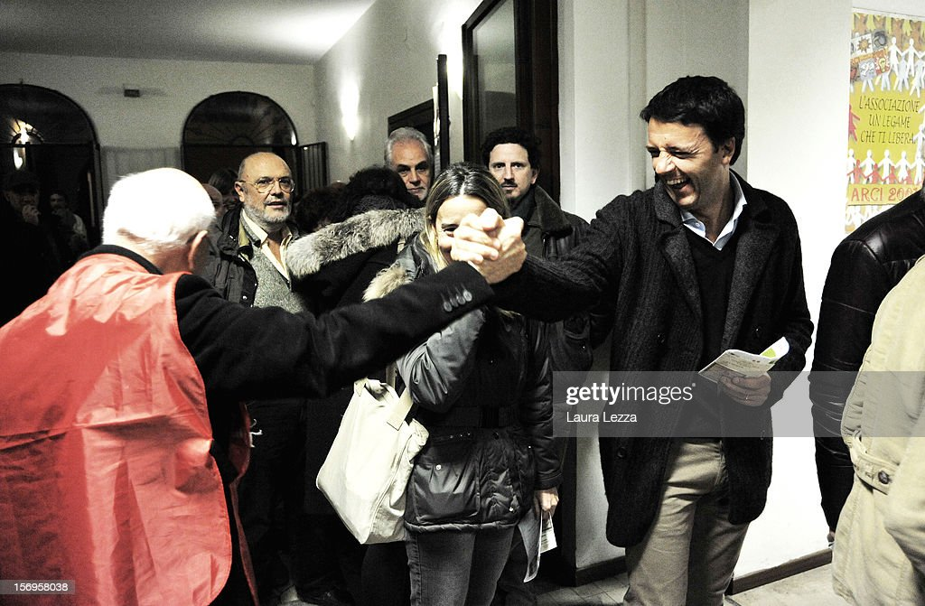Mayor of Florence <a gi-track='captionPersonalityLinkClicked' href=/galleries/search?phrase=Matteo+Renzi&family=editorial&specificpeople=6689301 ng-click='$event.stopPropagation()'>Matteo Renzi</a> greets voters while lining up to vote in the 2012 PD Primary Elections on November 25, 2012 in Florence, Italy. None of the five candidates won a 50 percent majority vote today. <a gi-track='captionPersonalityLinkClicked' href=/galleries/search?phrase=Matteo+Renzi&family=editorial&specificpeople=6689301 ng-click='$event.stopPropagation()'>Matteo Renzi</a>, who received more than 36 percent of the vote, will face the head of Italy's Democratic Party Pier Luigi Bersani in a runoff next weekend to choose the center-left leader that will be the candidate for the next Italian election to succeed Mario Monti.
