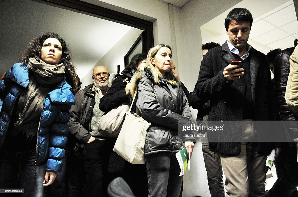 Mayor of Florence Matteo Renzi texts on his mobile phone while lining up to vote in the PD Primary Elections on November 25, 2012 in Florence, Italy. None of the five candidates won a 50 percent majority vote today. Matteo Renzi, who received more than 36 percent of the vote, will face the head of Italy's Democratic Party Pier Luigi Bersani in a runoff next weekend to choose the center-left leader that will be the candidate for the next Italian election to succeed Mario Monti.