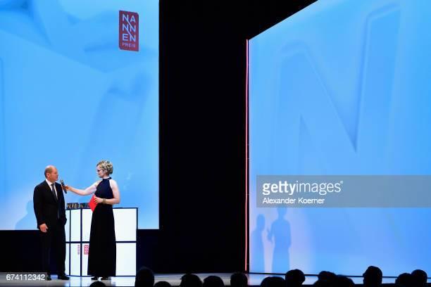 Mayor of Hamburg Olaf Scholz and Caren Miosga speak on stage at the Nannen Award 2017 on April 27 2017 in Hamburg Germany