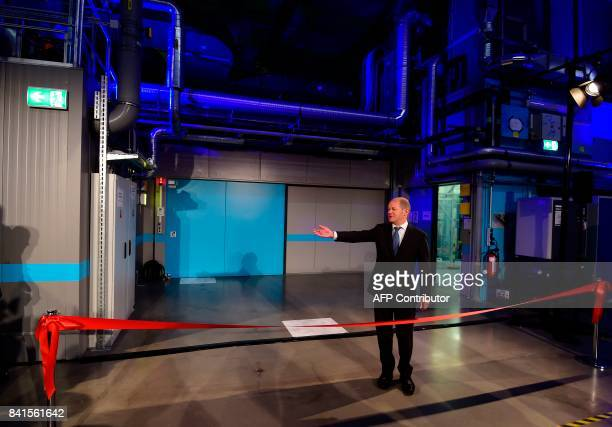 Mayor of Hamburg Olaf Scholz gestures during the official inauguration ceremony of the XFEL international research facility in Schenefeld near...
