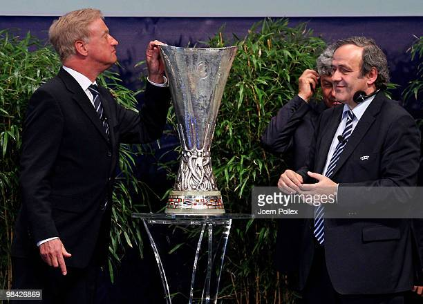 Mayor of Hamburg Ole Von Beust gets the UEFA Europa League cup from UEFA president Michel Platini during to the handover of the UEFA Europa League...