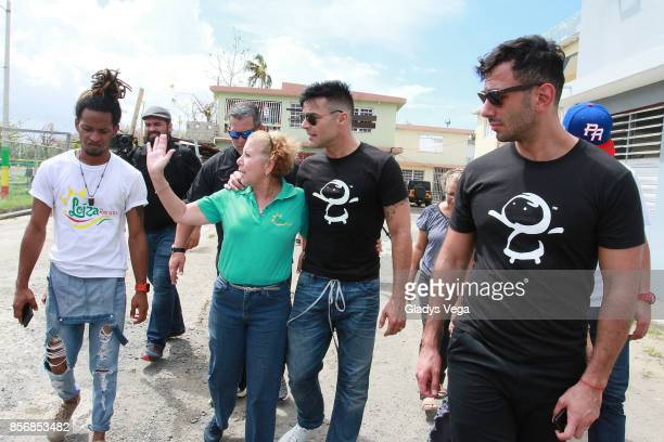 Mayor of Loiza Julia M Nazario Ricky Martin and Jwan Yosef deliver aid to victims of Hurricane Maria at the Loiza community on October 2 2017 in...
