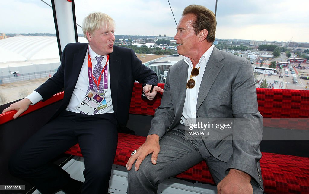 Mayor of London <a gi-track='captionPersonalityLinkClicked' href=/galleries/search?phrase=Boris+Johnson&family=editorial&specificpeople=209016 ng-click='$event.stopPropagation()'>Boris Johnson</a> and <a gi-track='captionPersonalityLinkClicked' href=/galleries/search?phrase=Arnold+Schwarzenegger&family=editorial&specificpeople=156406 ng-click='$event.stopPropagation()'>Arnold Schwarzenegger</a> take a ride on the Emirates cable car from Greenwich to the ExCeL in Docklands, after watching the Olympic basketball in Greenwich , on August 12, 2012 in London, England.