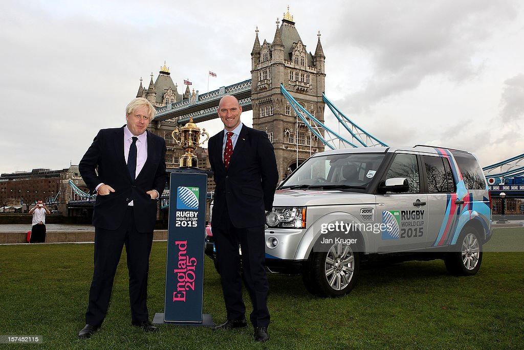 Mayor of London <a gi-track='captionPersonalityLinkClicked' href=/galleries/search?phrase=Boris+Johnson&family=editorial&specificpeople=209016 ng-click='$event.stopPropagation()'>Boris Johnson</a> and England Rugby 2015 ambassador and Rugby World Cup winner, <a gi-track='captionPersonalityLinkClicked' href=/galleries/search?phrase=Lawrence+Dallaglio&family=editorial&specificpeople=162771 ng-click='$event.stopPropagation()'>Lawrence Dallaglio</a>, pose with the Webb Ellis Cup and a Rugby World Cup 2015 branded Land Rover Discovery during a Land Rover photo call ahead of the Pool Allocation Draw at City Hall on December 3, 2012 in London, England.