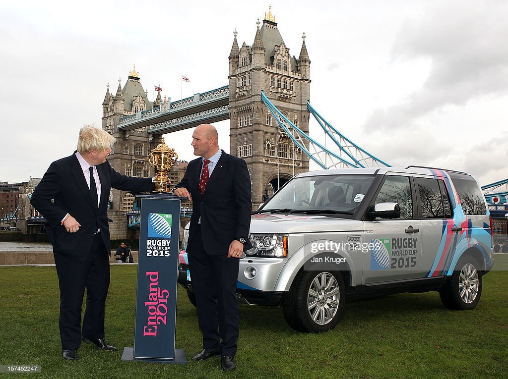 Mayor of London <a gi-track='captionPersonalityLinkClicked' href=/galleries/search?phrase=Boris+Johnson&family=editorial&specificpeople=209016 ng-click='$event.stopPropagation()'>Boris Johnson</a> and England Rugby 2015 ambassador and Rugby World Cup winner <a gi-track='captionPersonalityLinkClicked' href=/galleries/search?phrase=Lawrence+Dallaglio&family=editorial&specificpeople=162771 ng-click='$event.stopPropagation()'>Lawrence Dallaglio</a> pose with the Webb Ellis Cup and a Rugby World Cup 2015 branded Land Rover Discovery during a Land Rover photo call ahead of the Pool Allocation Draw at City Hall on December 3, 2012 in London, England.