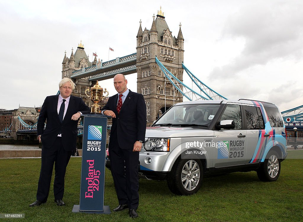 Mayor of London Boris Johnson and England Rugby 2015 ambassador and Rugby World Cup winner Lawrence Dallaglio pose with the Webb Ellis Cup and a Rugby World Cup 2015 branded Land Rover Discovery during a Land Rover photo call ahead of the Pool Allocation Draw at City Hall on December 3, 2012 in London, England.