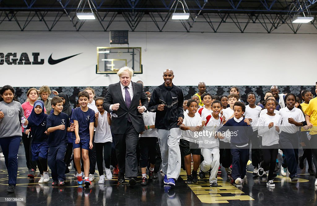 Mayor of London <a gi-track='captionPersonalityLinkClicked' href=/galleries/search?phrase=Boris+Johnson&family=editorial&specificpeople=209016 ng-click='$event.stopPropagation()'>Boris Johnson</a> and <a gi-track='captionPersonalityLinkClicked' href=/galleries/search?phrase=Mo+Farah&family=editorial&specificpeople=4819130 ng-click='$event.stopPropagation()'>Mo Farah</a> of Great Britain do some exercise with school kids whilst they were at Lilian Baylis Old School to announce the findings of a report published today, written by the Young Foundation and funded by Nike, which finds that physical inactivity costs the UK economy GBP 8.2bn per year. The Move It report warns that England faces an epidemic of physical inactivity unless the Government makes significant changes to the nation's sporting infrastructure. For more information www.designedtomove.org on October 1, 2012 in London, England.