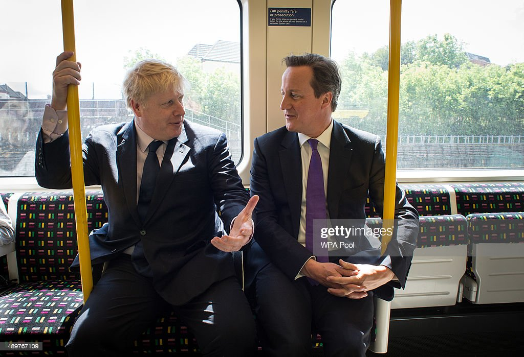 Mayor of London Boris Johnson and Prime Minister David Cameron sit on an underground train as they head back to Westminster after visiting Harrow...