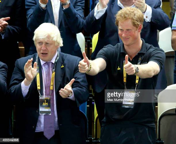 Mayor of London Boris Johnson and Prince Harry watch Wheelchair Rugby in the Copper Box Arena during the Invictus Games on September 12 2014 in...