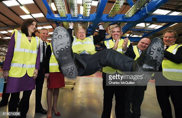 Mayor of London Boris Johnson attempts a pull up while inspecting one of the ordered London buses at Wrightbus' Antrim factory watched by among...