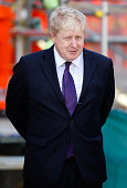 Mayor of London Boris Johnson awaits the arrival of Queen Elizabeth II for a visit to the Crossrail station site at Bond Street on February 23 2016...