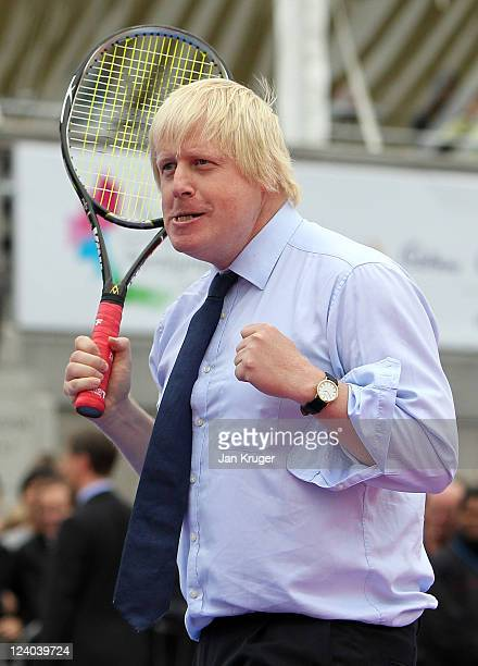 Mayor of London Boris Johnson celebrates winning a point against the Prime Minister during the International Paralympic Day at Trafalgar Square on...