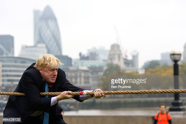 Mayor of London Boris Johnson competes in a tug of war during the launch of London Poppy Day on October 27 2015 in London England Poppies have been...