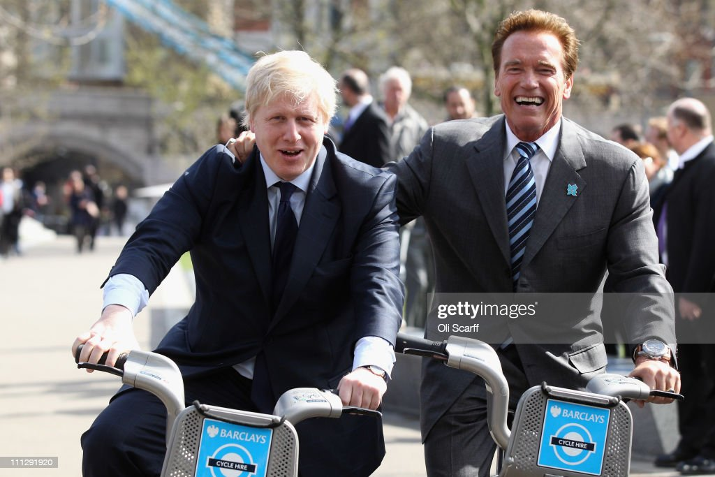 Mayor of London <a gi-track='captionPersonalityLinkClicked' href=/galleries/search?phrase=Boris+Johnson&family=editorial&specificpeople=209016 ng-click='$event.stopPropagation()'>Boris Johnson</a> (L) cycles London Cycle Hire bikes with former Governor of California <a gi-track='captionPersonalityLinkClicked' href=/galleries/search?phrase=Arnold+Schwarzenegger&family=editorial&specificpeople=156406 ng-click='$event.stopPropagation()'>Arnold Schwarzenegger</a> in front of City Hall on March 31, 2011 in London, England. Mr Johnson has today met with Mr Schwarzenegger to exchange ideas on how to encourage low and zero emission technologies.