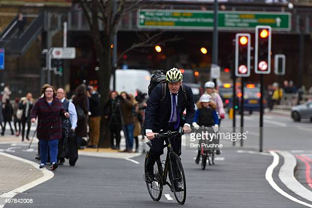 Mayor of London Boris Johnson cycles over Vauxhall Bridge to launch London's first cycle superhighway on November 19 2015 in London England...