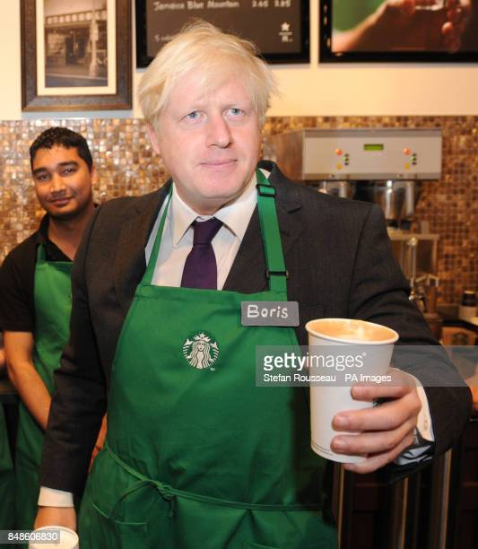 Mayor of London Boris Johnson holds a drink in a Starbucks in Mayfair London where they announced an initiative for the coffee chain to hire more...