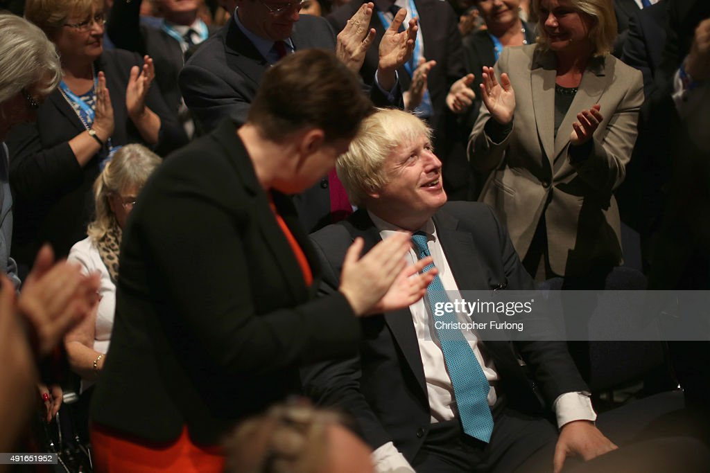 Mayor of London Boris Johnson is appluaded by the audience after Prime Minister David Cameron thanked him in his keynote speech to delegates on the fourth and final day of the Conservative Party Conference, at Manchester Central on October 7, 2015 in Manchester, England. Mr Cameron announced plans to encourage developers to build 200,000 new 'affordable' homes for first time buyers. The initiative is set up to secure the homes by the end of the parliament, and is one of the key election pledges of the Conservative's election campaign.
