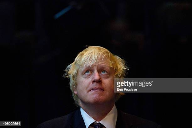 Mayor of London Boris Johnson listens to speeches during the annual GLA remembrance service in City Hall on November 6 2015 in London England The...