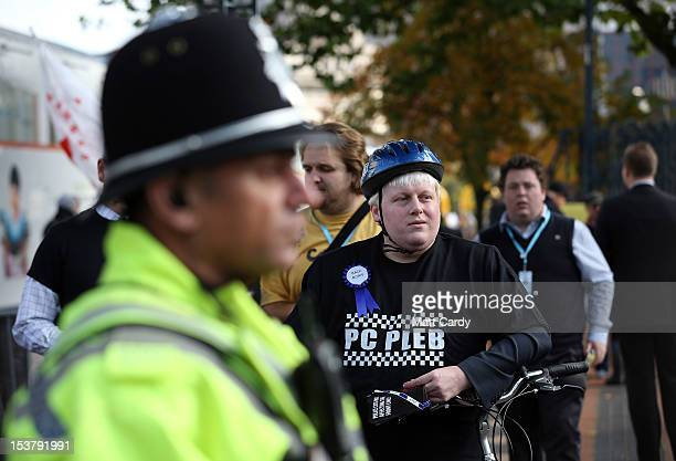 Mayor of London Boris Johnson lookalike protests as part of a police federation photo call outside the Conservative party conference at the...