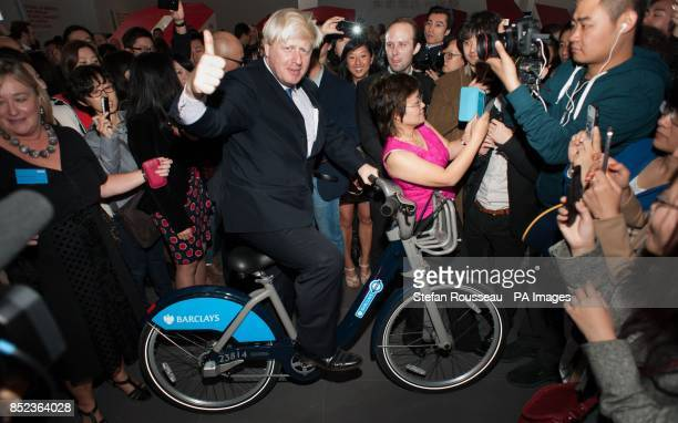 Mayor of London Boris Johnson on a 'Boris Bike' begins a sixday trade mission meeting former and current students from the UK and Beijing at the...