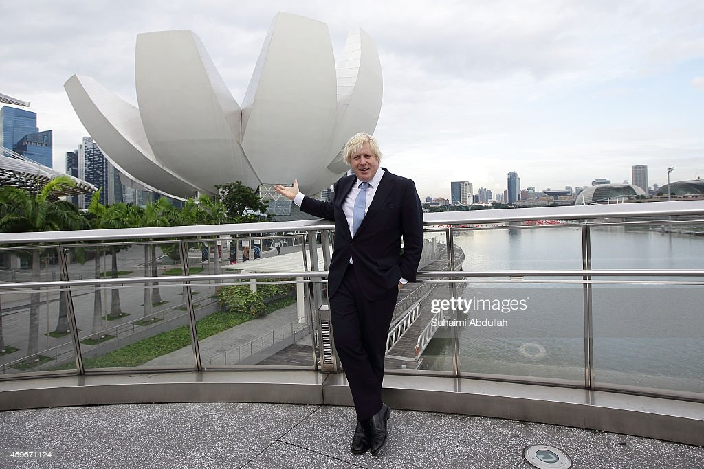 Mayor of London, <a gi-track='captionPersonalityLinkClicked' href=/galleries/search?phrase=Boris+Johnson&family=editorial&specificpeople=209016 ng-click='$event.stopPropagation()'>Boris Johnson</a> poses for photographers at the Helix Bridge at Marina Bay prior to speaking at the FinTech event at the ArtScience Museum on November 28, 2014 in Singapore. Mayor <a gi-track='captionPersonalityLinkClicked' href=/galleries/search?phrase=Boris+Johnson&family=editorial&specificpeople=209016 ng-click='$event.stopPropagation()'>Boris Johnson</a> is on a six day trade mission to the Far East to build on his work to create jobs and growth, and promote London as a major investment destination as he leads a trade mission to Singapore, Jakarta and Kuala Lumpur.