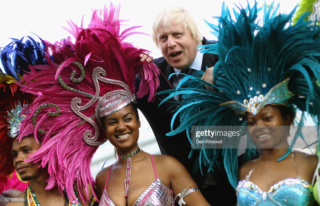 Mayor of London <a gi-track='captionPersonalityLinkClicked' href=/galleries/search?phrase=Boris+Johnson&family=editorial&specificpeople=209016 ng-click='$event.stopPropagation()'>Boris Johnson</a> poses with members of Notting Hill Carnival mas band Genesis during a photocall on August 24, 2011 in London, England. The Notting Hill Carnival is due to take place on August 28 and 29.