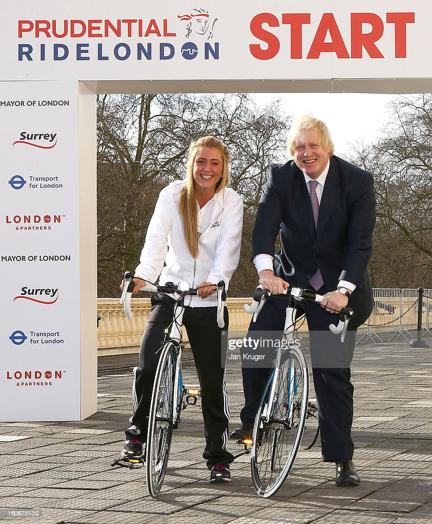 Mayor of London Boris Johnson poses with Olympic Double Gold medallist Laura Trott during the Prudential RideLondon Announcement at Prince Phillip House on February 7, 2013 in London, England.