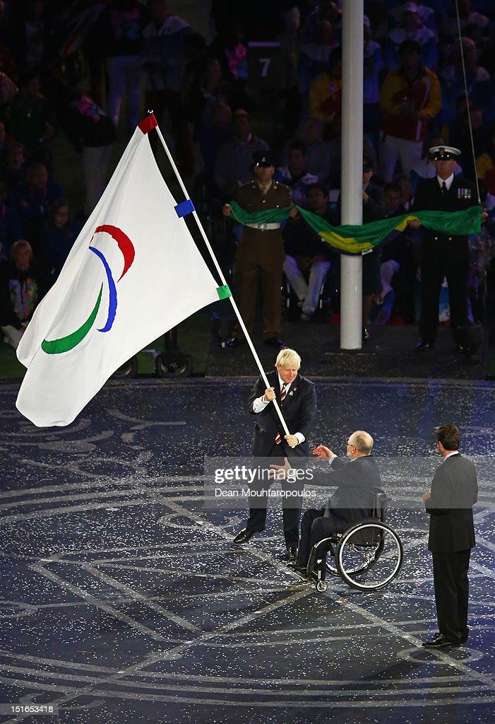 Mayor of London Boris Johnson President of the IPC Sir Philip Craven MBE and Mayor of Rio de Janeiro Eduardo Paes perform the Paralympic flag...