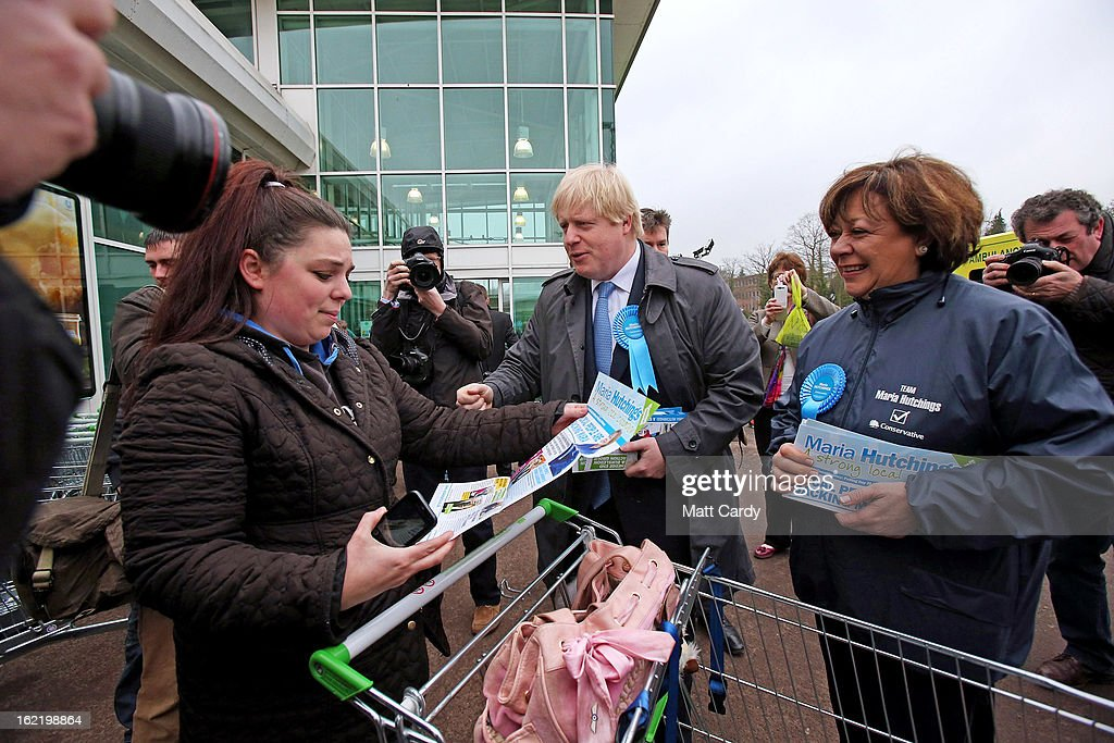 Mayor Of London <a gi-track='captionPersonalityLinkClicked' href=/galleries/search?phrase=Boris+Johnson&family=editorial&specificpeople=209016 ng-click='$event.stopPropagation()'>Boris Johnson</a> (C) speaks to a shopper as he arrives at an ASDA superstore with Conservative candidate <a gi-track='captionPersonalityLinkClicked' href=/galleries/search?phrase=Maria+Hutchings&family=editorial&specificpeople=2542017 ng-click='$event.stopPropagation()'>Maria Hutchings</a> (R) during a visit to the constituency on February 20, 2013 in Eastleigh, Hampshire. A by-election has been called in the constituency of Eastleigh after its former MP, Chris Huhne, resigned after pleading guilty to perverting the course of justice over claims his ex-wife took speeding points for him in 2003.