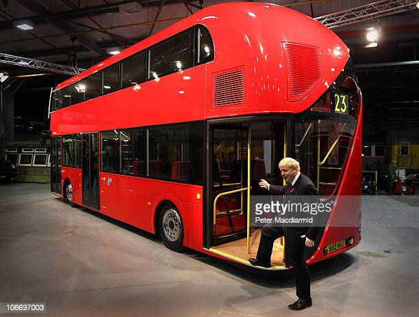 Mayor of London Boris Johnson stands on a mockup of the New Bus for London in Acton on November 11 2010 in London England The new bus will come into...