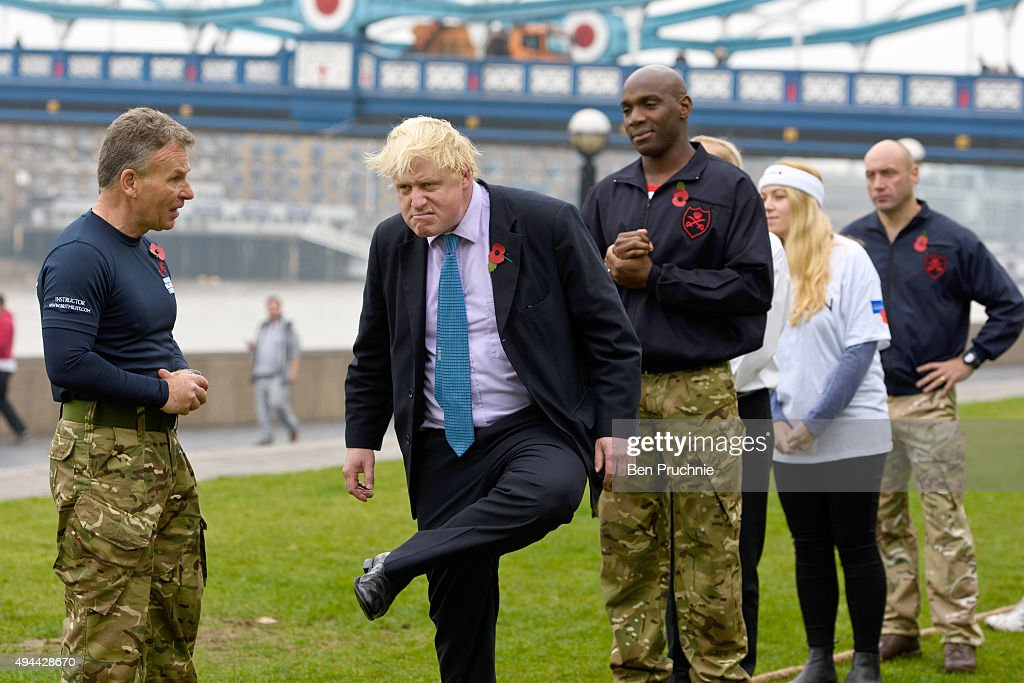 Mayor of London Boris Johnson stretches ahead of a tug of war during the launch of London Poppy Day on October 27 2015 in London England Poppies have...
