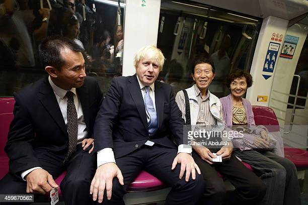 Mayor of London Boris Johnson takes a train ride on the Singapore underground mass rapid system after attending the FinTech event at the ArtScience...